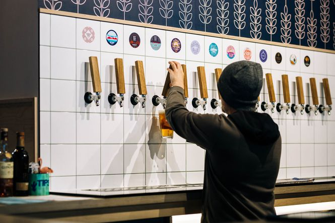 A man pouring beer.