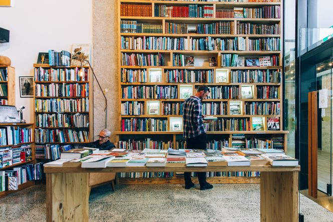 A man browsing books inside Browsers Bookshop in Hamilton.
