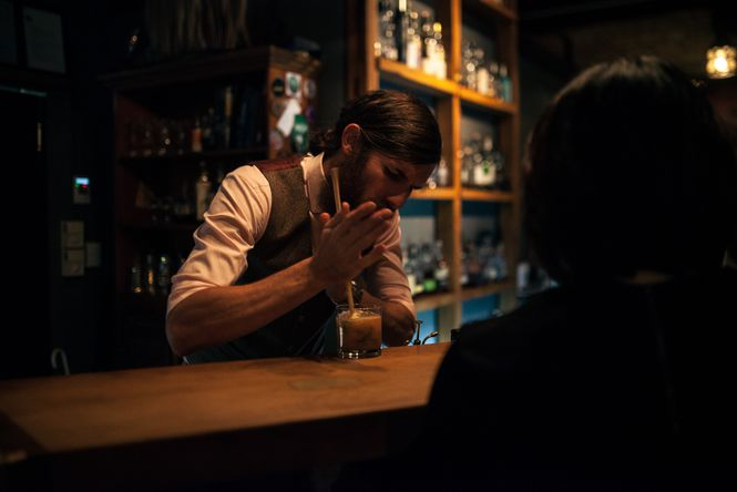 A bar man making a cocktail at Wonder Horse.
