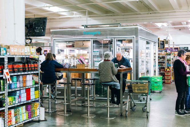 People dining at a table inside Moore Wilsons.