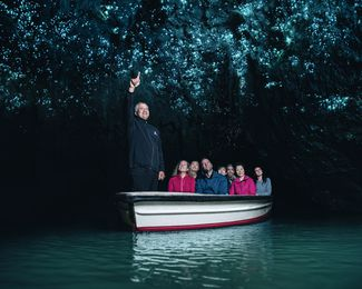 People in a boat in a cave.