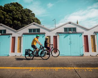 Two people biking.